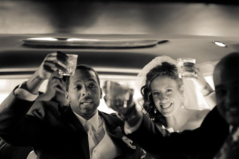 bride and groom in limosine