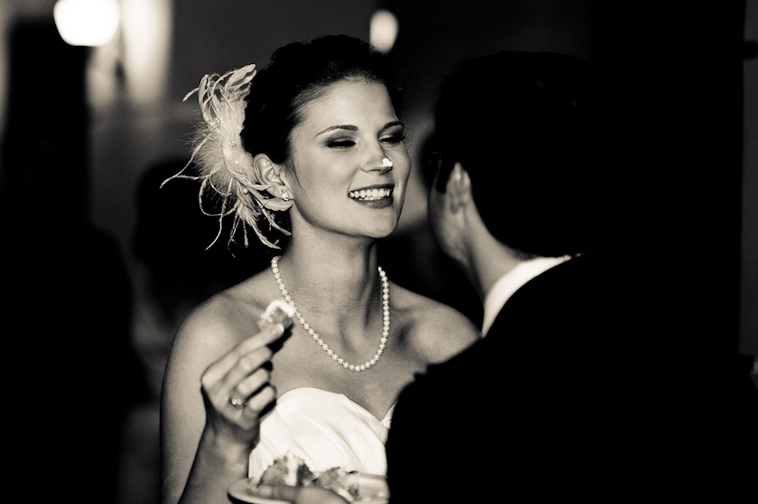 groom laughing at the cake on her nose during austin wedding photography