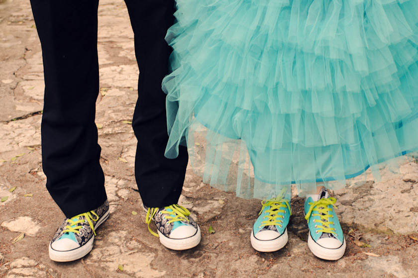 converse shoes with bride and groom