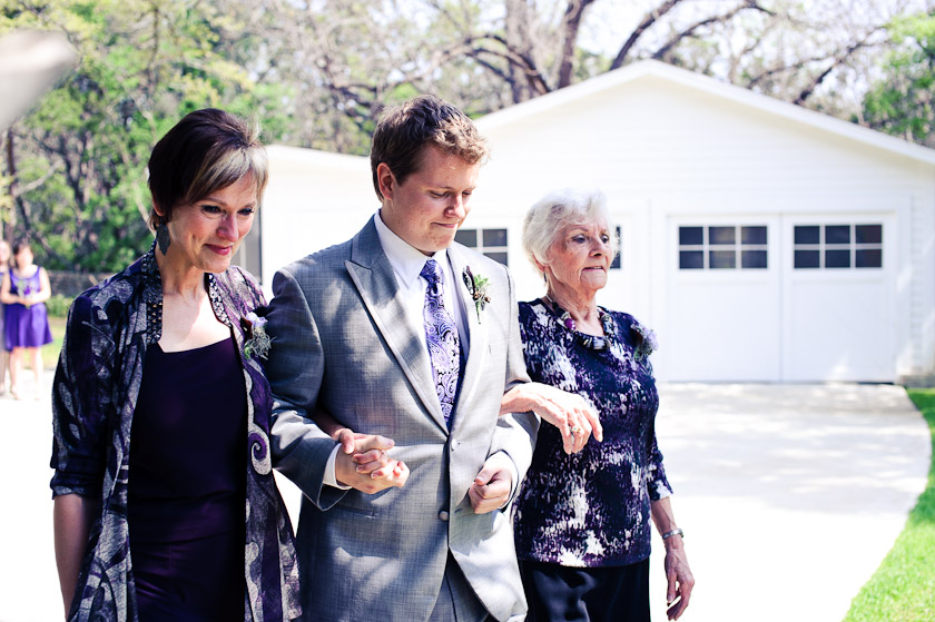 groom walking down with mother and grandmother