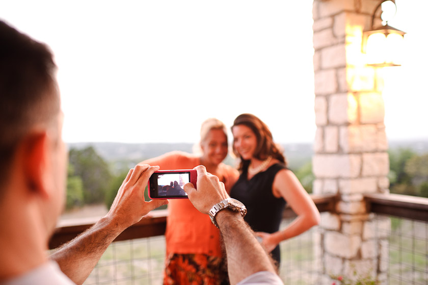 guest taking a picture with an iphone