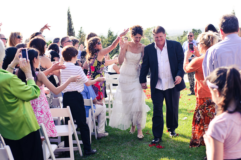 lavender being thrown at the bride and groom