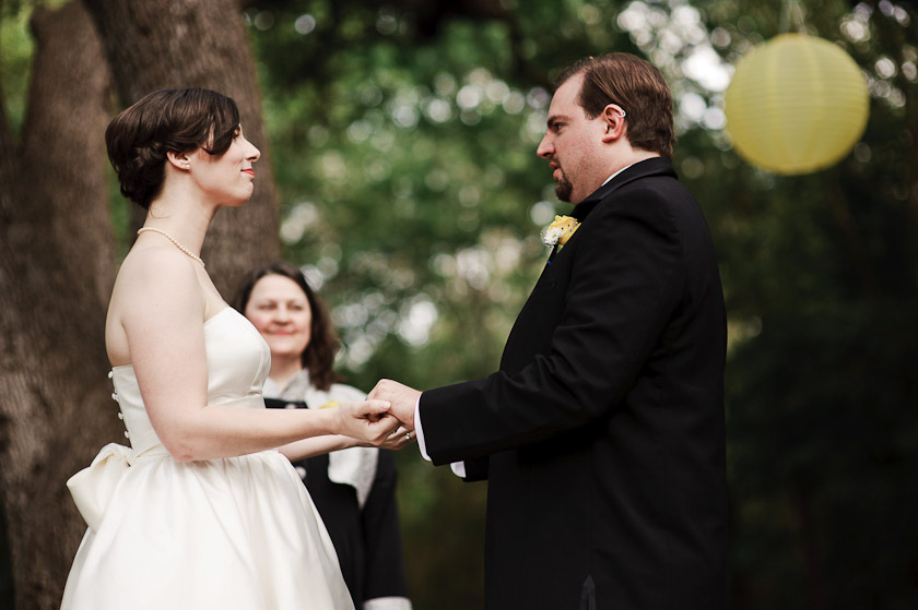holding hands during the outdoor ceremony