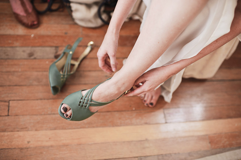 bride putting on shoes in a vintage airstream