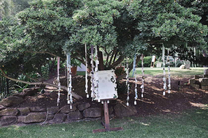 vintage bells stitched on ribbons hanging on tree