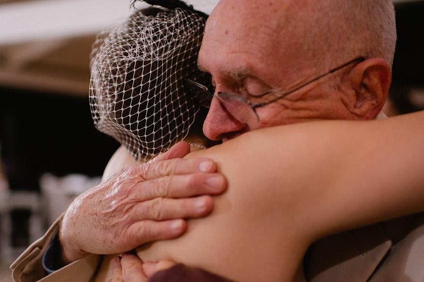 hugging at a reception