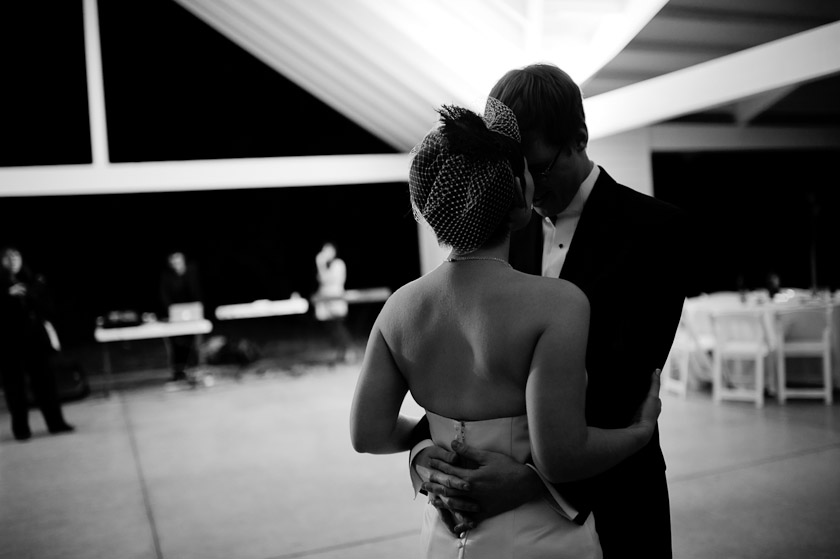black and white picture of bride and groom dancing