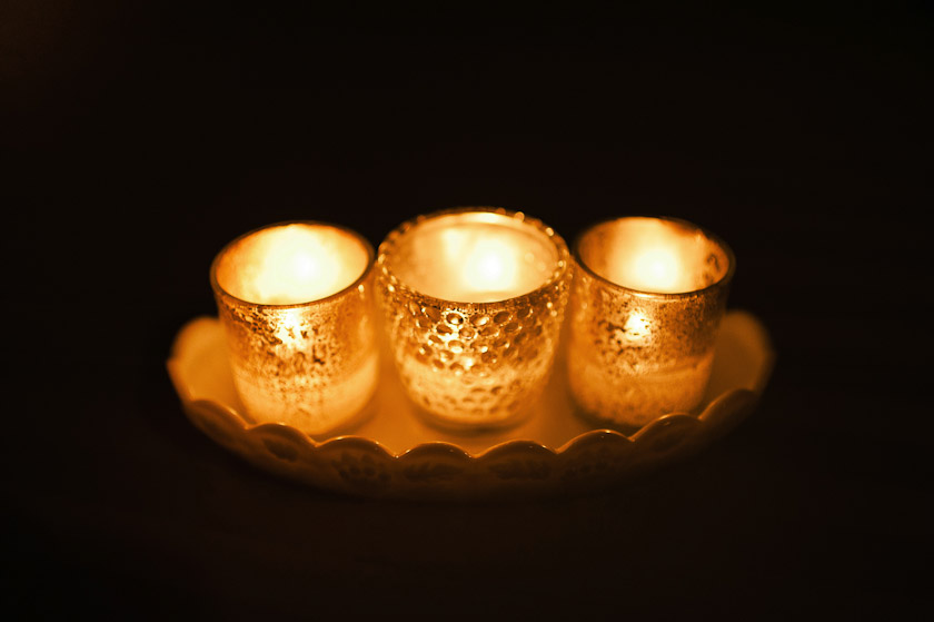 milk glass acting as candle holders for a wedding