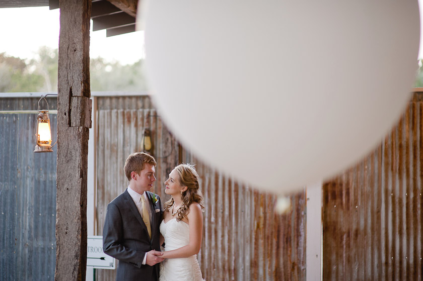 bride and groom portraits with giant balloons