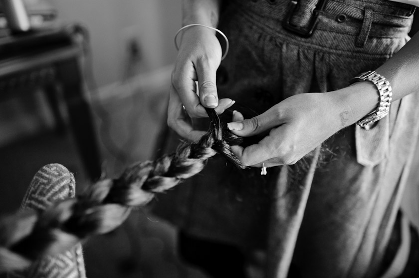 black and white picture of braiding hair