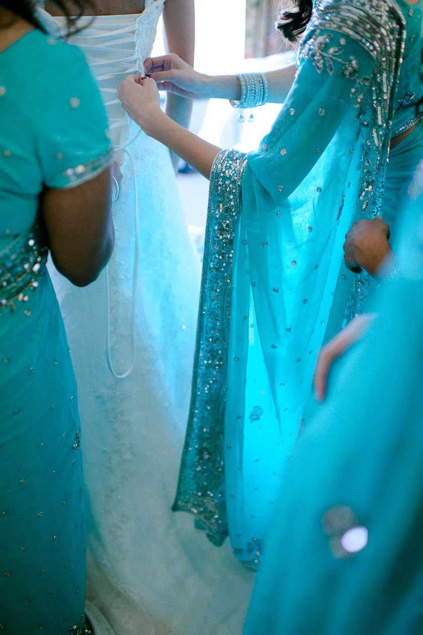 getting ready in blue saris with the bride and bridesmaids