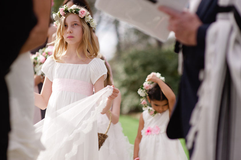 flower girls during the ceremony at the hummingbird house