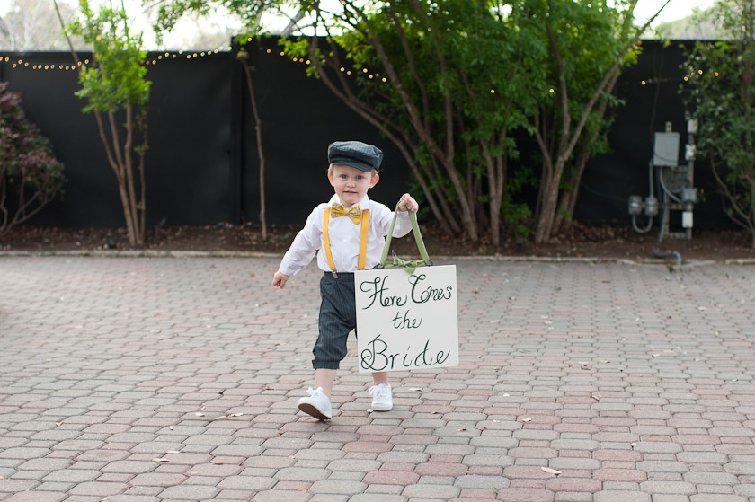 here comes the bride sign carried by a little boy