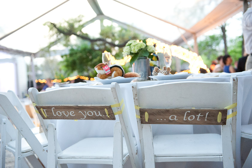 wooden board signs of i love you and a lot on the bride and groom chairs
