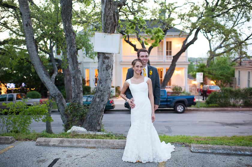 bride and groom in front of the allan house in austin, texas