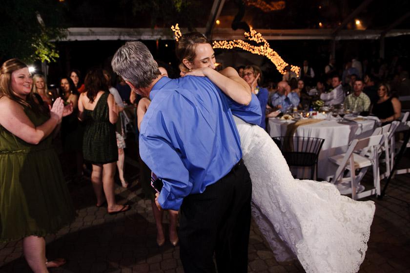 bride being swung around during the wedding