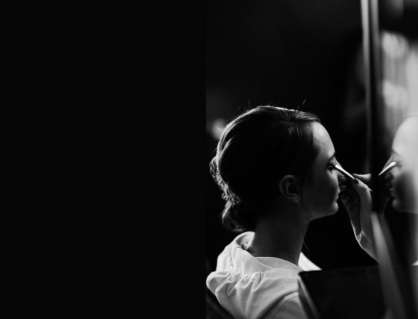 bride putting on makeup