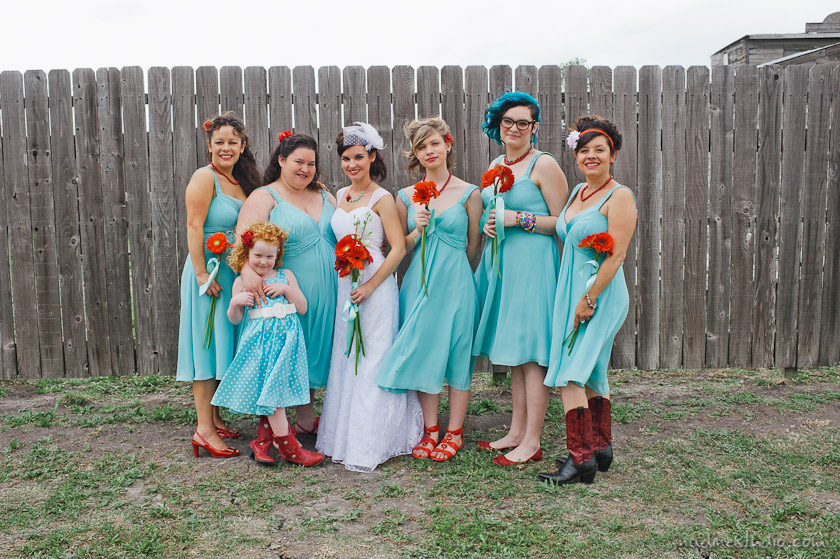 bridesmaid in blue and red flowers
