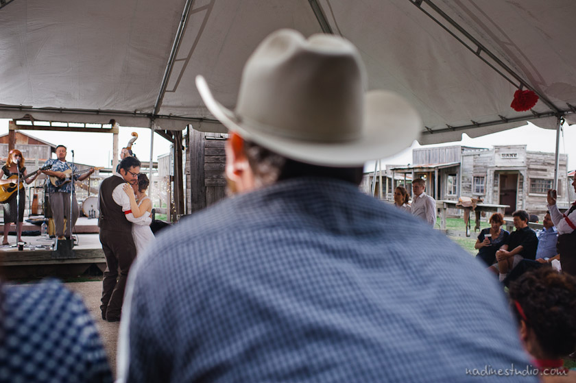 cowboy hat and bride and groom