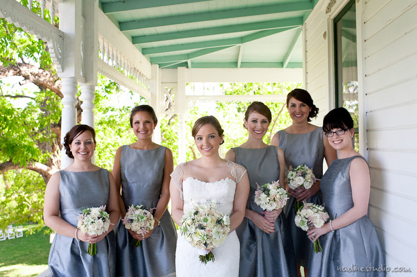 bride and bridesmaids in gray dresses