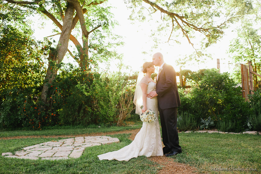 bride and groom at the barr mansion sunset