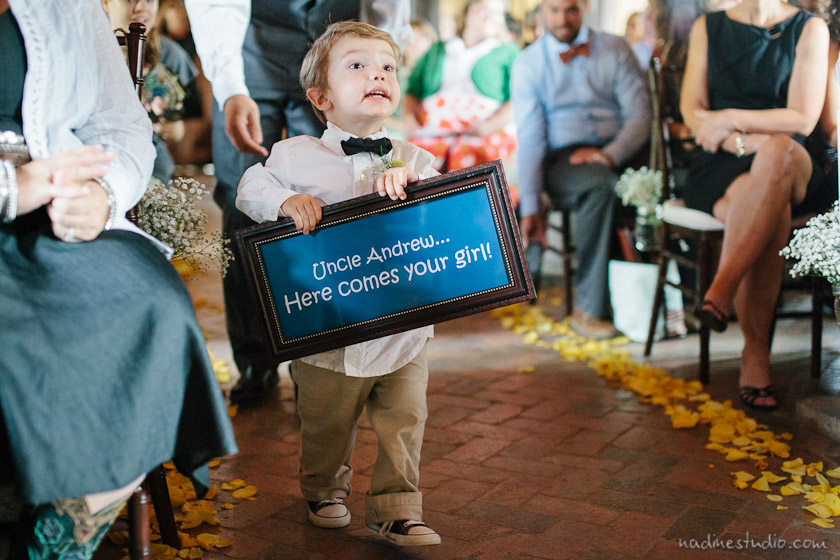 uncle andrew, here comes your bride sign carried by ringbearer