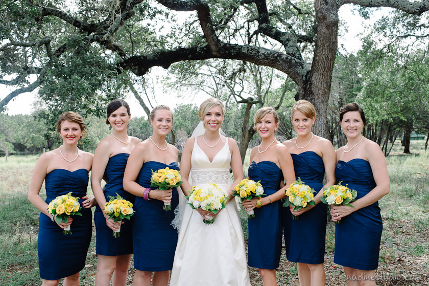 bridesmaids in blue dress and yellow flowers