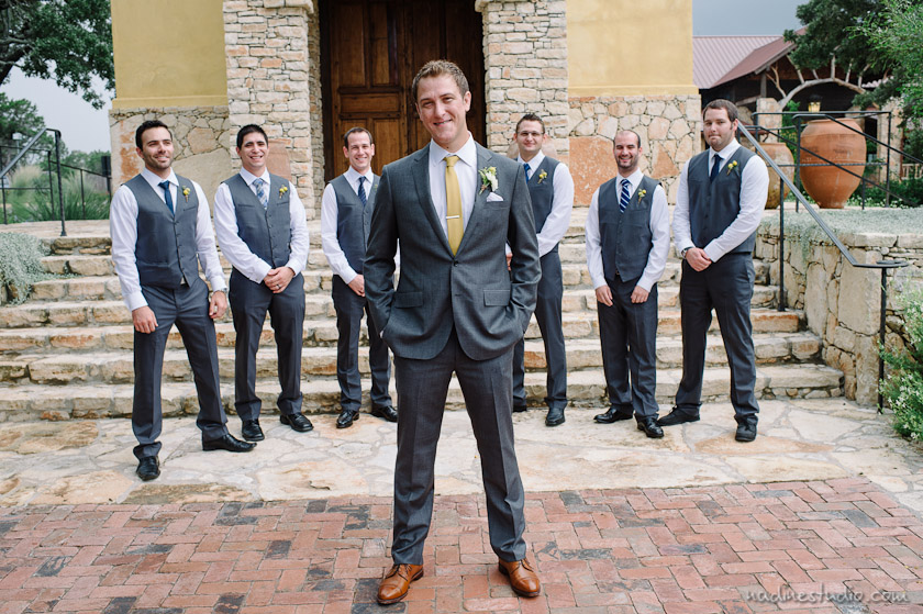 groomsmen in vest gray with yellow flowers