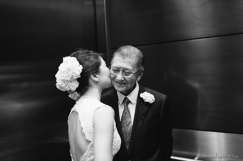 bride kissing father on the cheek