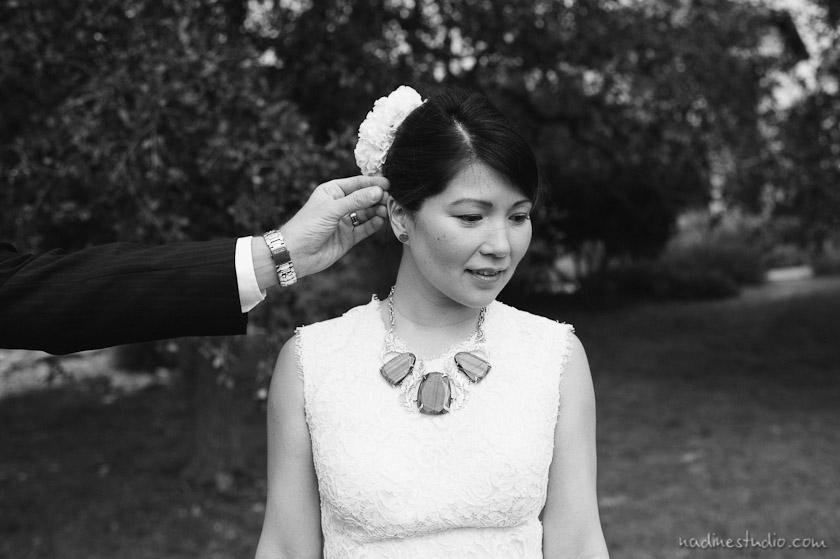 groom fixing bride