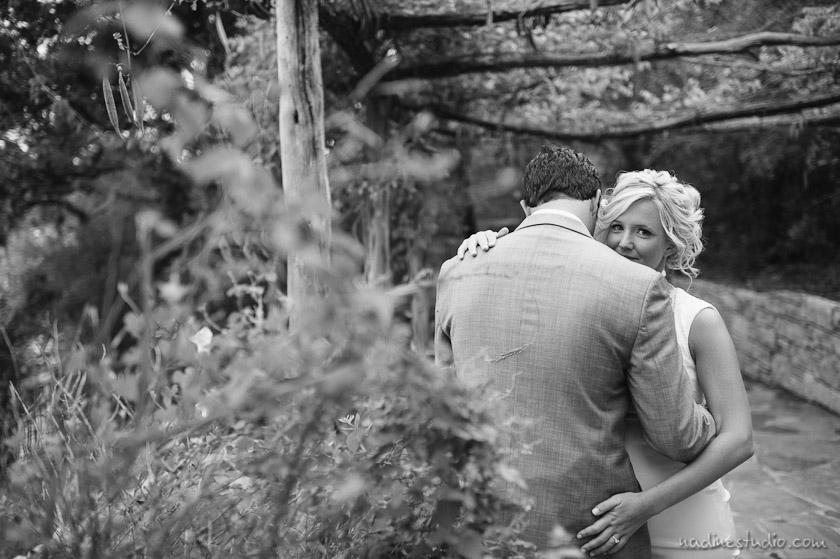 bride peeking over groom