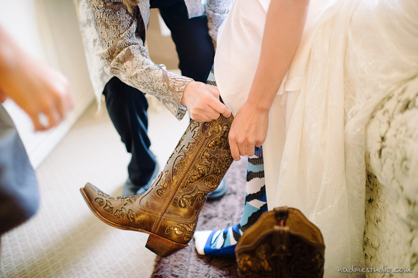 bride putting on texas boots
