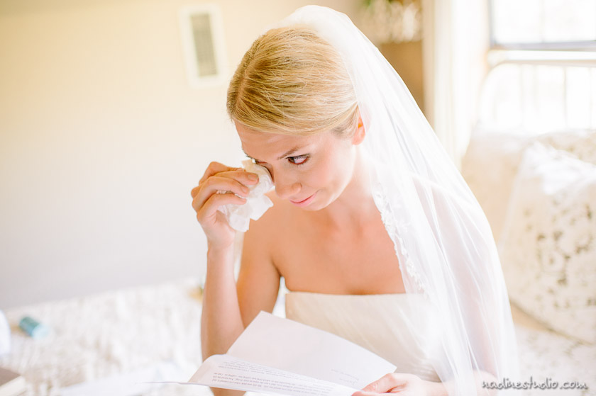 bride crying while reading eltter from the groom