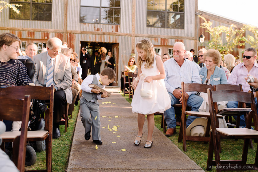 flower girl and ring bearer throwing corn during wedding