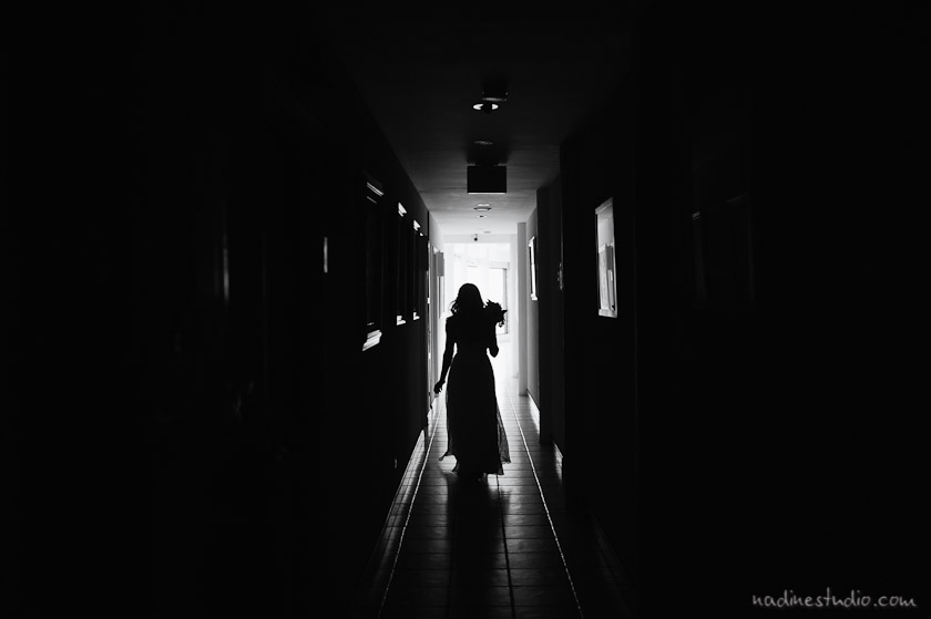 bride walking down dark hallway