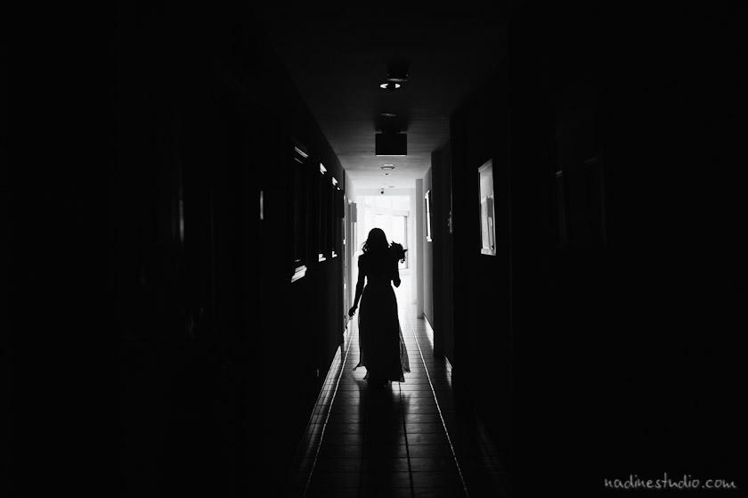 bride walking down dark hallway