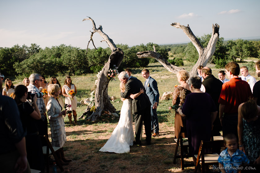 ceremony amoung tree trunks