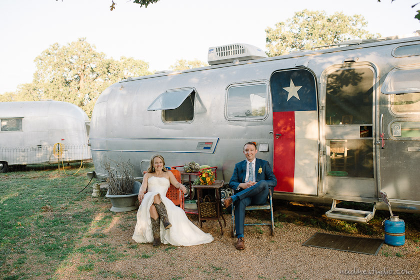 bride and groom in front of a texas vintage airstream trailer