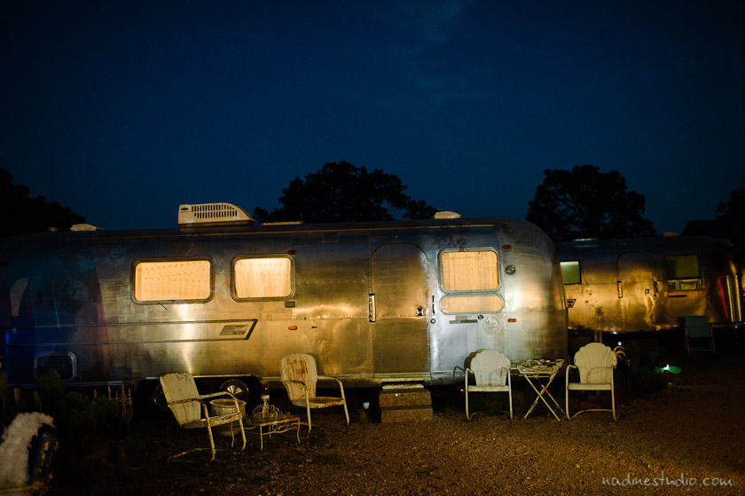 airstream trailer lit up at night