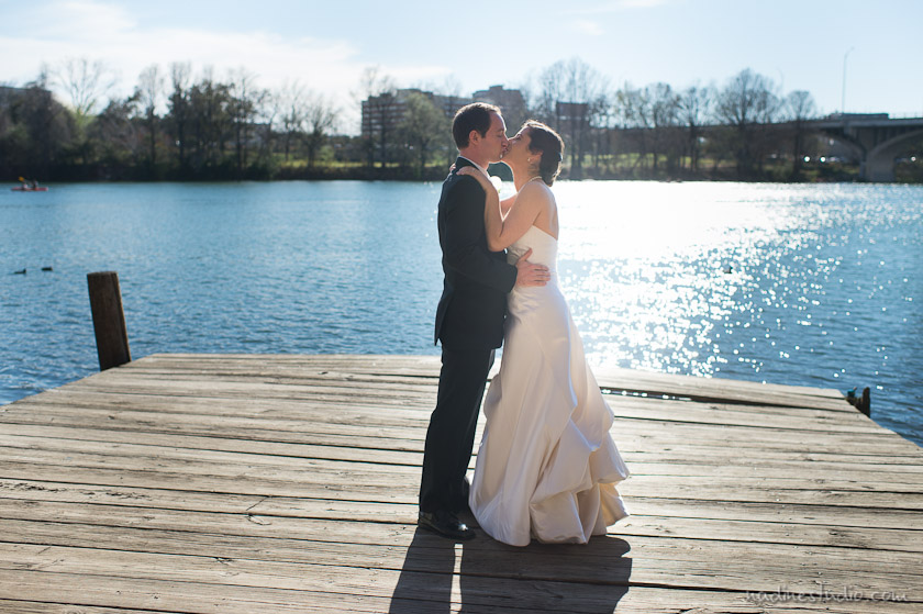bride and groom at the dock by austin town lake