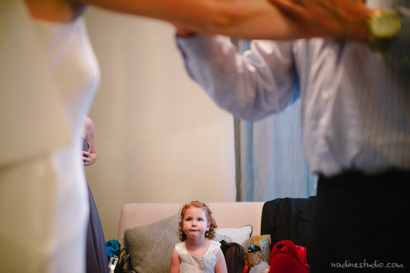 flower girl looking as bride gets ready