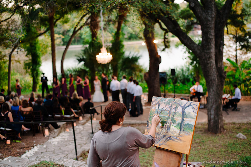 a painter painting the wedding ceremony