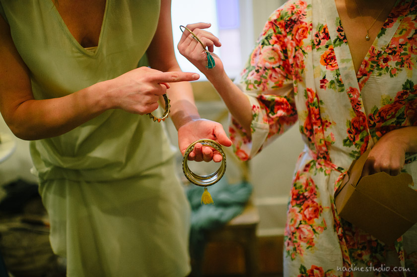 putting on bracelets with bridesmaids