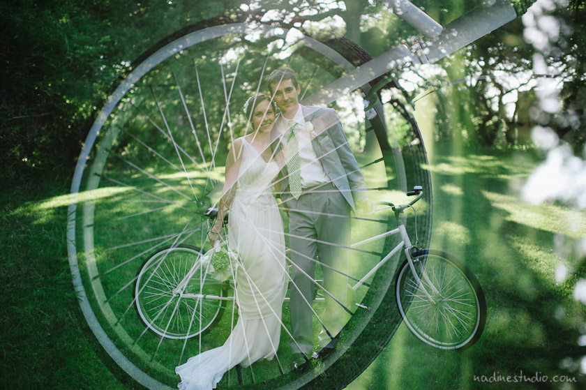 bride and groom on bicycle double exposure