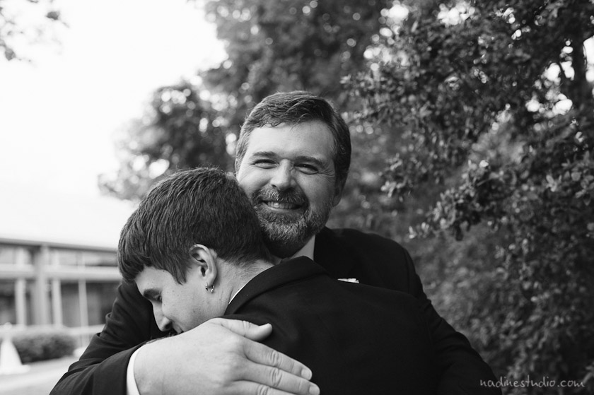 groom hugging his son