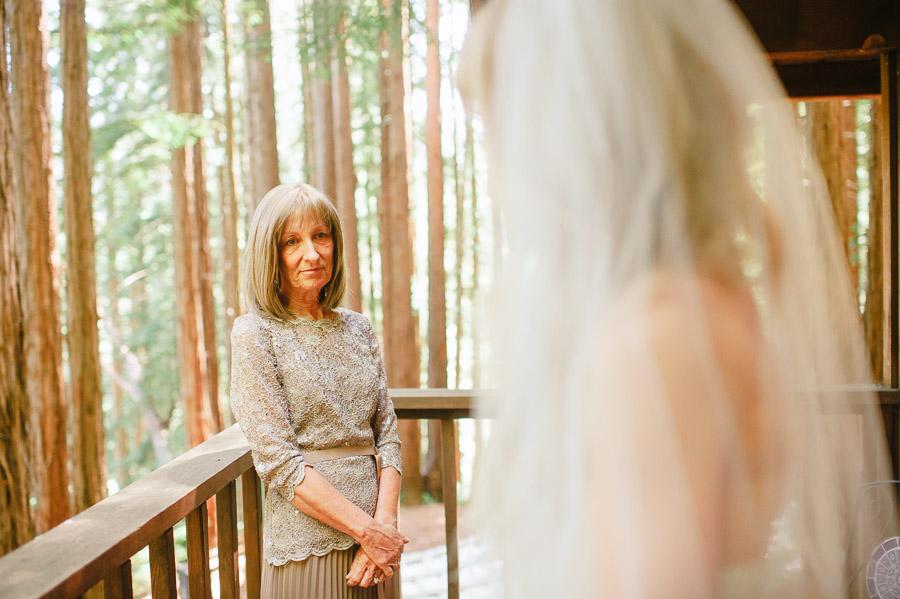 mother of bride seeing the bride in her wedding dress