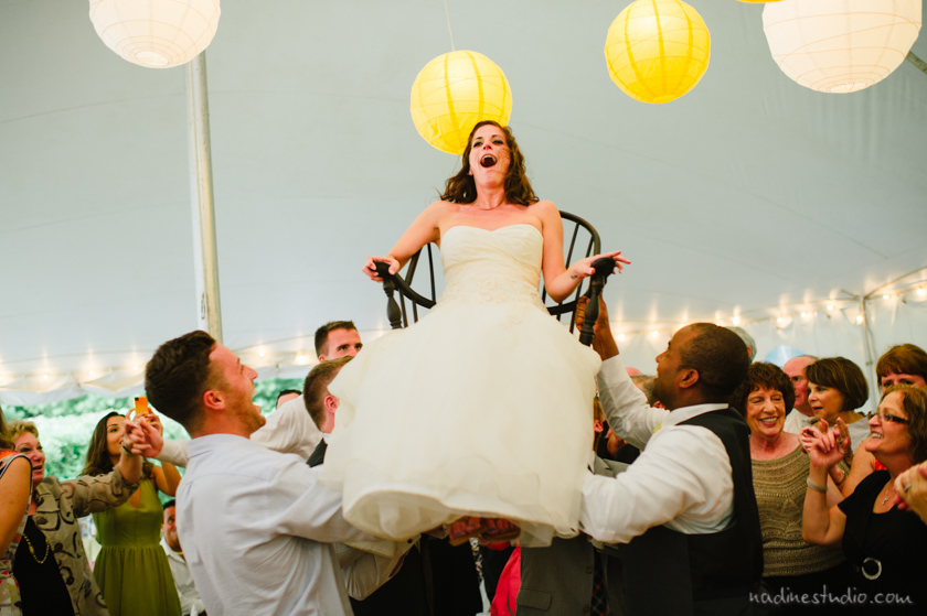 bride liefted up in a chair