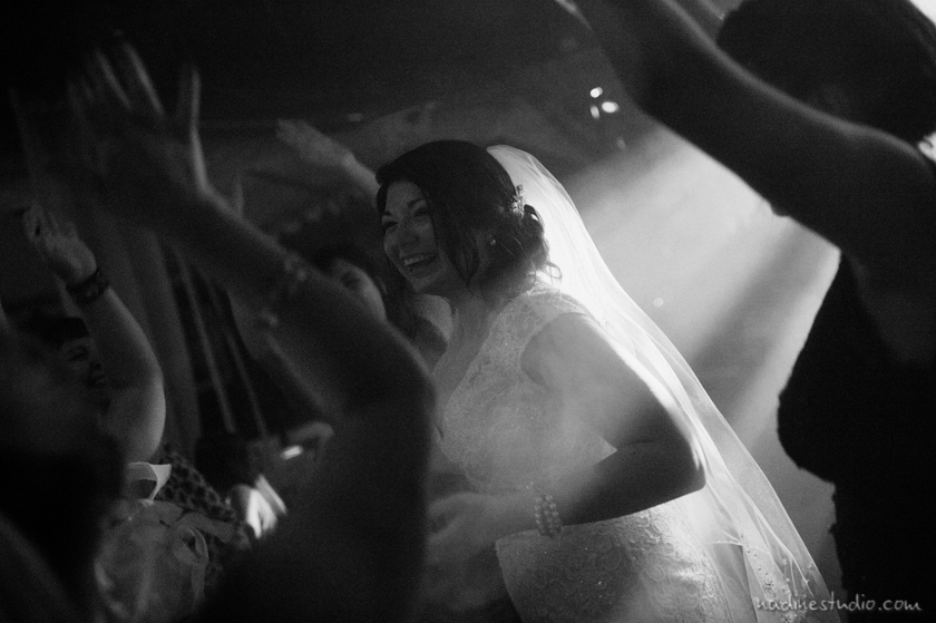 black and white bride dancing