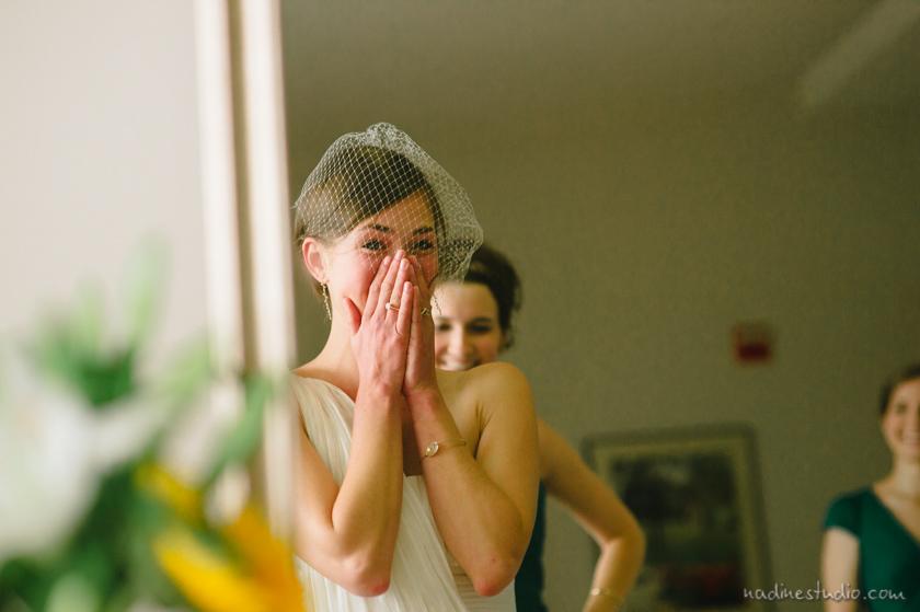 bride seeeing herself at mirror