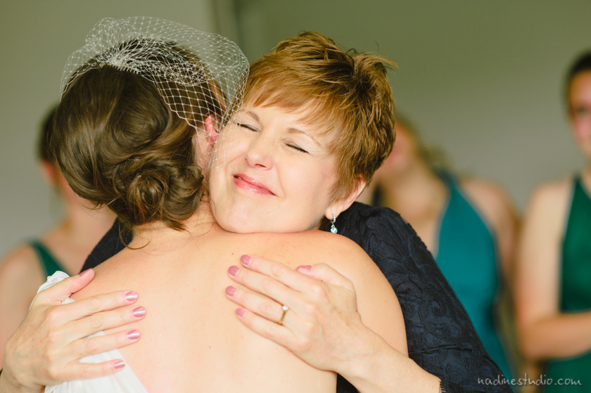mother of bride hugging bride